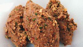 Pollo al curry con arachidi