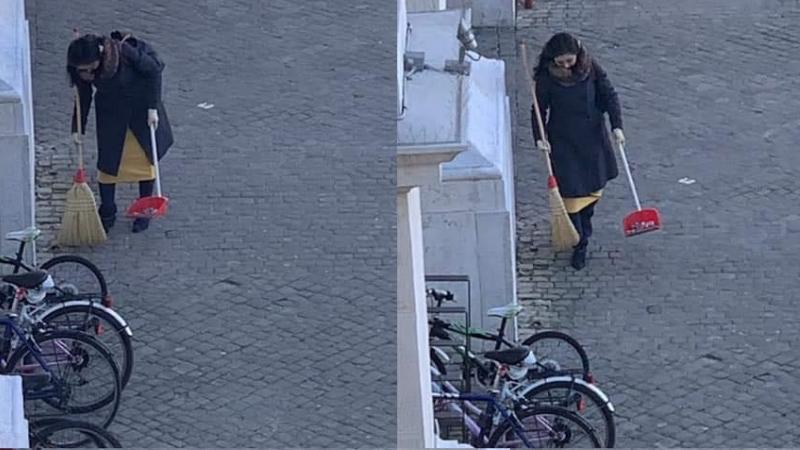 pesaro donna pulisce strada