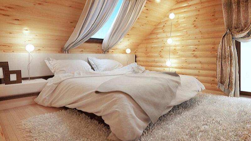 5 idee per illuminare una camera da letto con tetto in legno