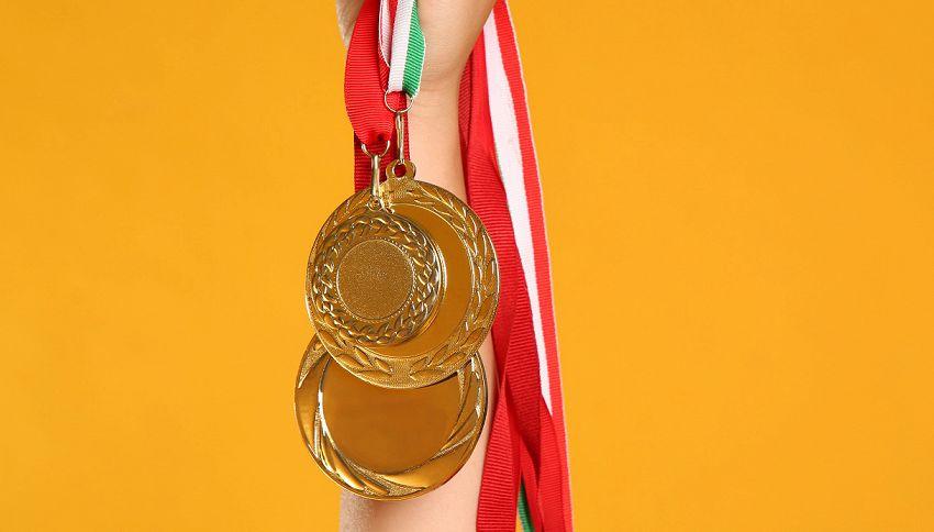 Olimpiadi, da dove nasce il gesto di mordere la medaglia