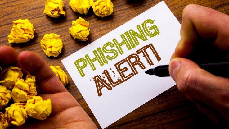 Un cartello scritto a penna con la scritta Phishing Alert