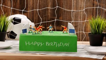 Birthday football cake on the party or reception