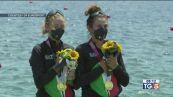 Tre medaglie da canottaggio e nuoto