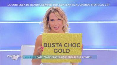 A ''Live'' una busta choc gold per la Contessa De Blanck